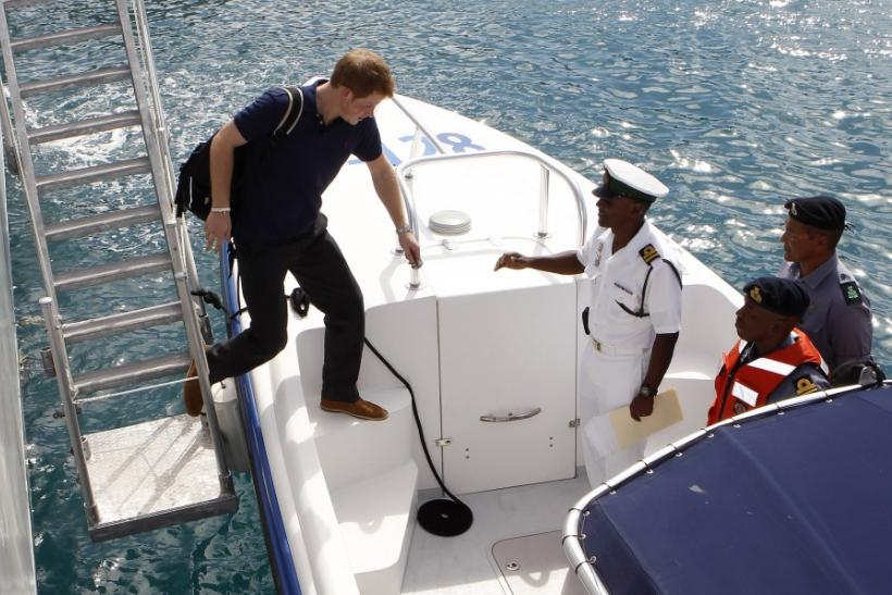 Prince Harry hops on a Boat