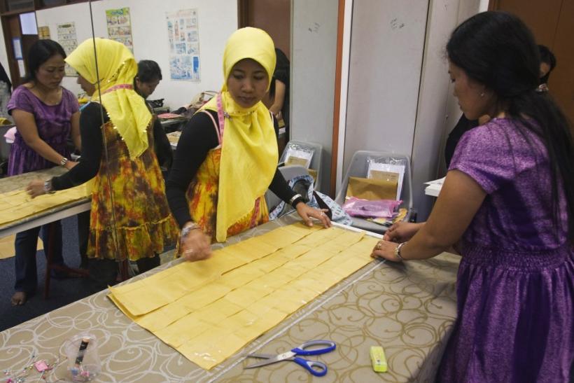 Indonesian domestic workers attend a sewing class during their day off at the Indonesian School in Singapore