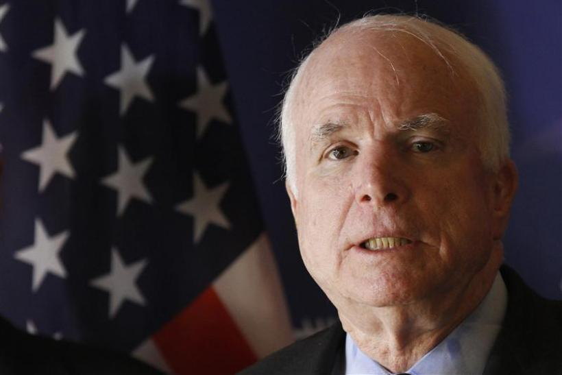 U.S. Senator John McCain speaks during a news conference in Tripoli