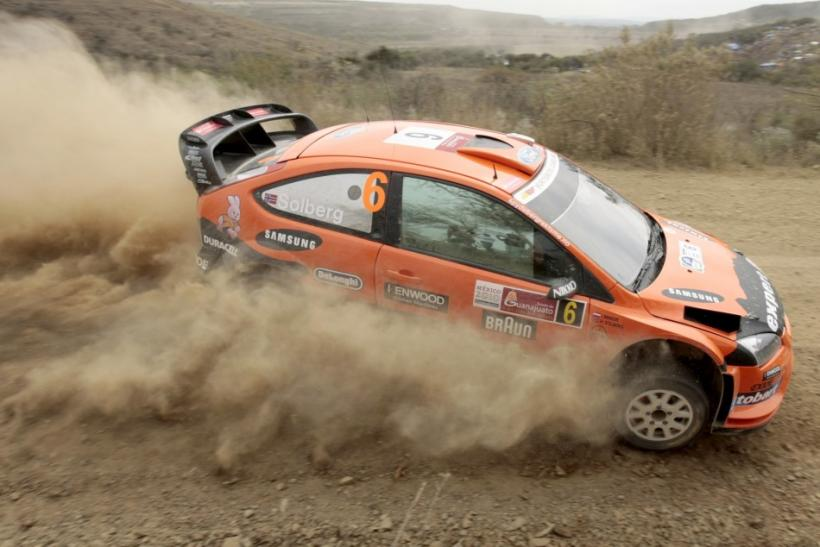 A Ford Focus RS kicks up some dust in WRC Rally Mexico 2010.