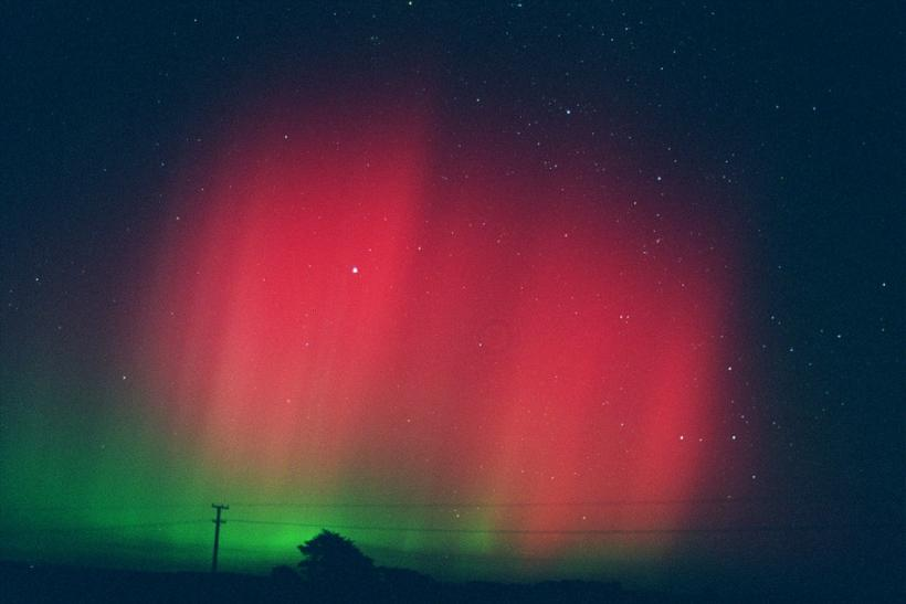 "Aurora Australis, or the ""Southern Lights"", glow in the sky over the town of Glenn Ourua near Palmeston North, north of New Zealand's national capital Wellington on April 1, 2001, in the area's most dramatic display since 1989."