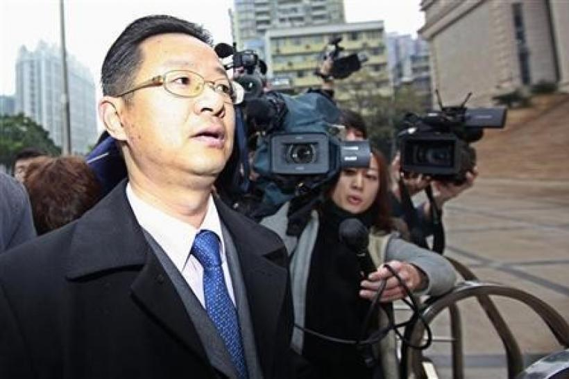Xie Xianghui, a lawyer representing Proview Technology (Shenzhen) is surrounded by reporters as he walks into the Higher People's Court of Guangdong in Guangzhou, Guangdong province February 29, 2012.