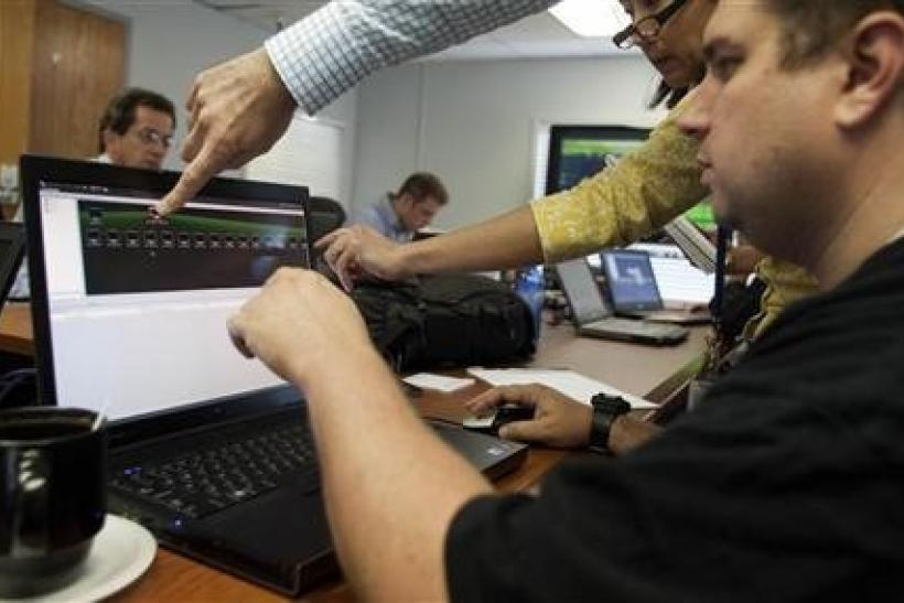 Attacking team members work to hack into a network during a drill at a Department of Homeland Security cyber security defense lab at the Idaho National Laboratory in Idaho Falls, Idaho, September 30, 2011.
