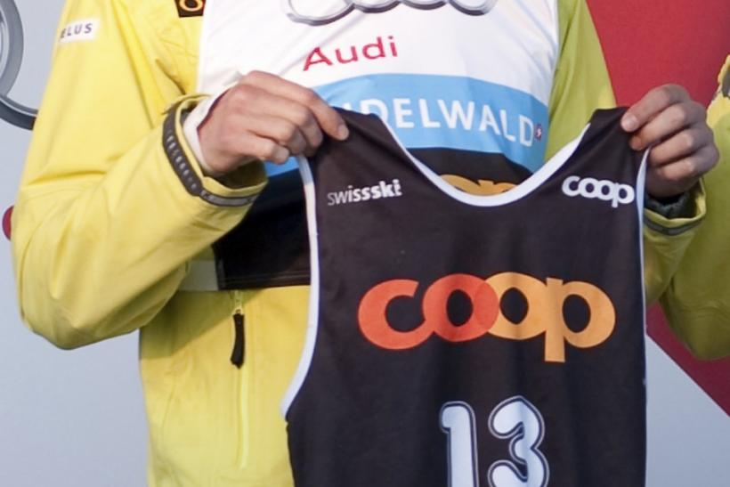 Canada's Zoricic presents his start number during a ceremony before a FIS skicross world cup event in Grindelwald