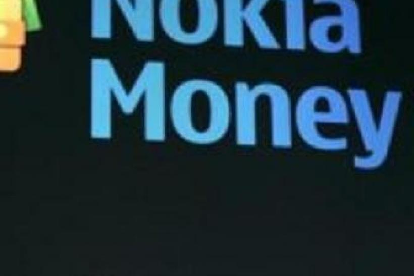 Nokia President and Chief Executive Olli-Pekka Kallasvuo talks about money transfers with mobile phones during the 2010 International Consumer Electronics Show (CES) in Las Vegas, Nevada January 8, 2010.