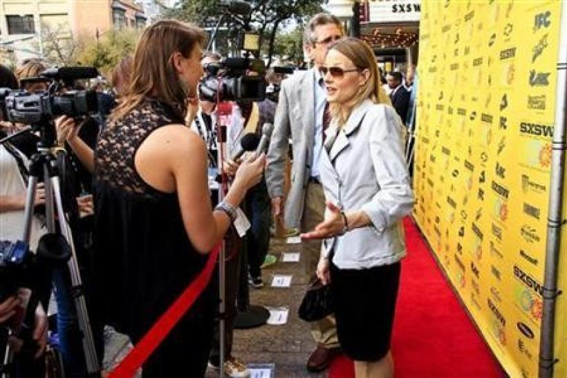 "Jodie Foster speaks to reporters as she arrives for the premiere of ""The Beaver"" at The Paramount Theater during the SXSW Film Festival in Austin, Texas March 16, 2011."