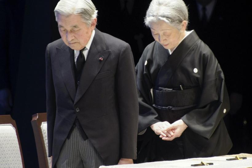 Japanese Emperor Akihito and Empress Michiko, bow during the national memorial service for tsunami and earthquake victims in Tokyo