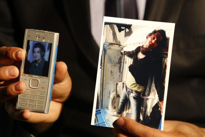 A gay activist known by his pseudonym Roby Hurriya shows pictures of his friend Saif Asmar before and after Asmar was killed during an interview with Reuters in Baghdad