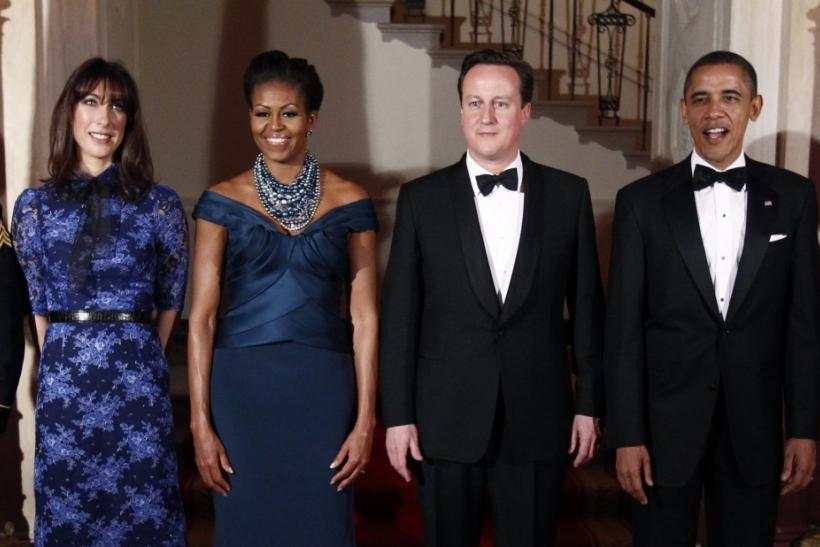 U.S. President Barack Obama (R) and first lady Michelle (2nd L) welcome British Prime Minister David Cameron and his wife Samantha to the White House for a State Dinner in Washington March 14, 2012.
