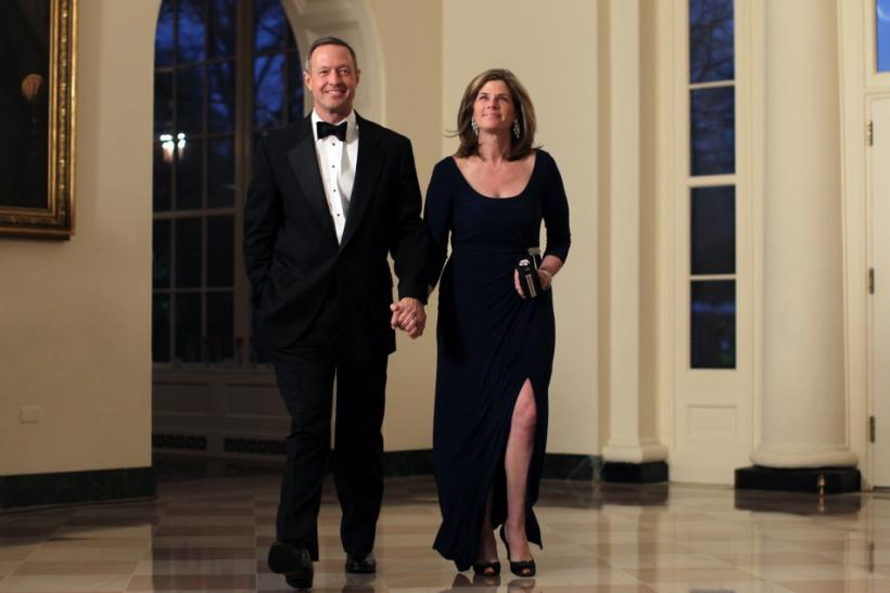 Maryland Governor Martin O'Malley and his wife Katie arrive for a State Dinner held in honor of Britain's Prime Minister David Cameron and his wife Samantha at the White House in Washington March 14, 2012.