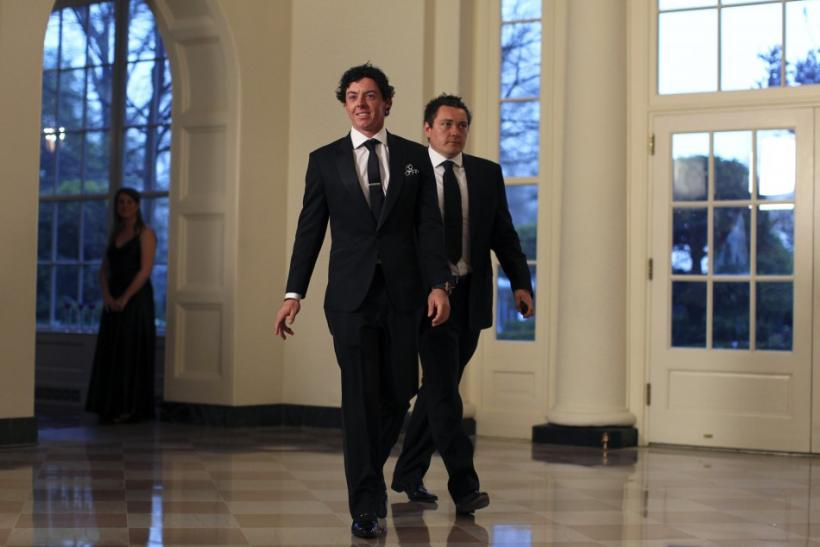 Golfer Rory McIlroy and Conor Ridge (R) arrive for a State Dinner held in honor of Britain's Prime Minister David Cameron and his wife Samantha at the White House in Washington March 14, 2012.