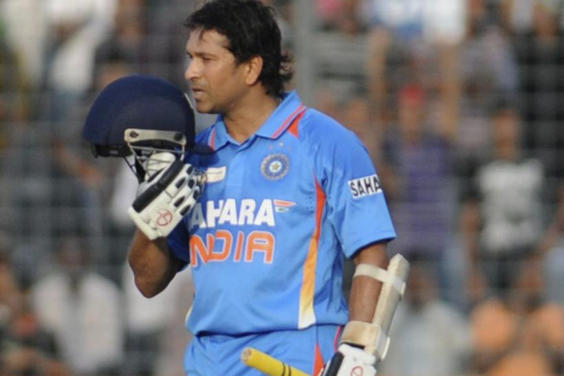 India's Sachin Tendulkar celebrates after he scored his 100th international centuries against Bangladesh during their One Day International (ODI) cricket match of Asia Cup in Dhaka March 16, 2012.