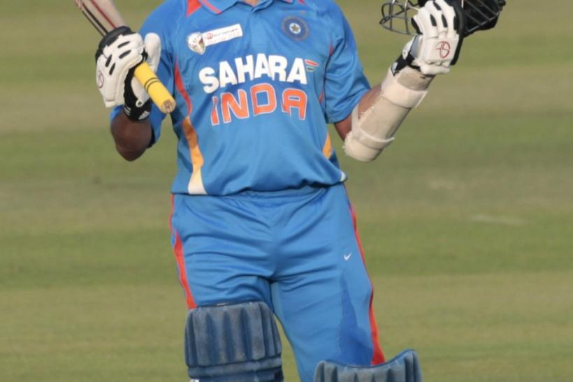India's Sachin Tendulkar celebrates after he scored his 100th centuries against Bangladesh during their One Day International (ODI) cricket match of Asia Cup in Dhaka March 16, 2012.