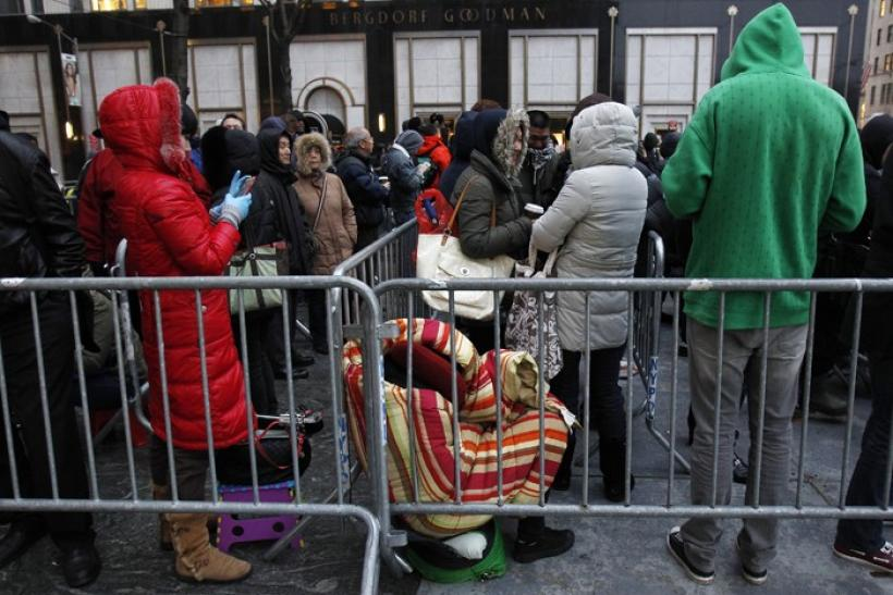 People wait in line to purchase Apple's new iPad in New York