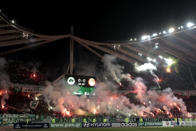 The Greece League game between Panathinaikos and Olympiakos was abandoned after fans set fire to parts of the stadium.