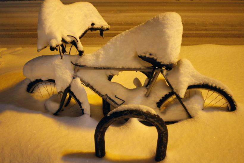 Several inches of snow cover a bicycle in Flagstaff, Arizona March18, 2012. The late winter storm kept temperatures well below normal in California on Sunday and generated heavy snow fall in several states, including Arizona, where several highways in the