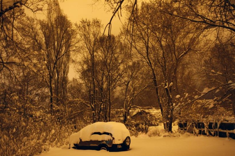 Several inches of snow cover a parked vehicle in Flagstaff, Arizona March,18 2012. The late winter storm kept temperatures well below normal in California on Sunday and generated heavy snow fall in several states, including Arizona, where several highways