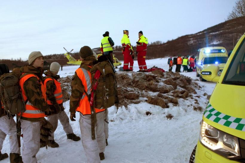 Rescue personnel prepare to go to a mountain area where an avalanche is reported, in Kafjord