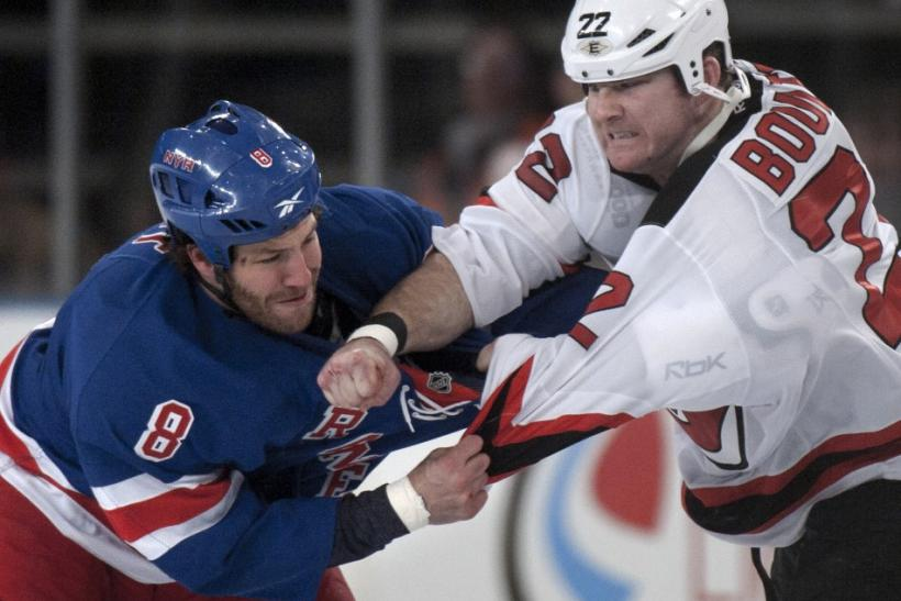 Brandon Proust and Eric Boulton square off in a pre-arranged fight at the start of a game between the Rangers and Devils.