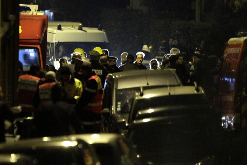 French police and emergency services gather on a street during a raid on a building to arrest a suspect in the killings of three children and a rabbi on Monday at a Jewish school, in Toulouse