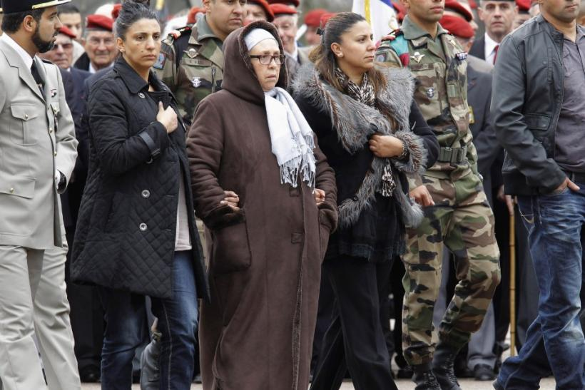 Unidentified relatives of victims arrive to a ceremony to pay homage to the three soldiers at the 17th RGP paratroopers regiment in Montauban