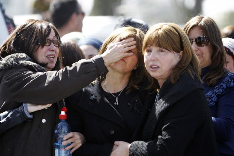 Mourners attend a joint funeral in Jerusalem for victims of Monday's shooting in Toulouse