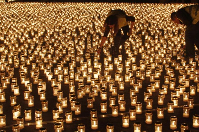 People light candles at Praca do Comercio in Lisbon December 17, 2011