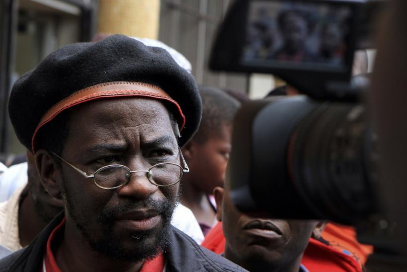 Munyaradzi Gwisai, a former opposition lawmaker in Prime Minister Morgan Tsvangirai's party speaks to the media at the Harare Magistrate court March 20, 2012.