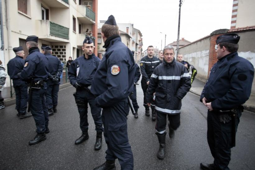 Police forces block a street during a raid on a house to arrest suspects in the killings of three children and a rabbi on Monday at a Jewish school, in Toulouse