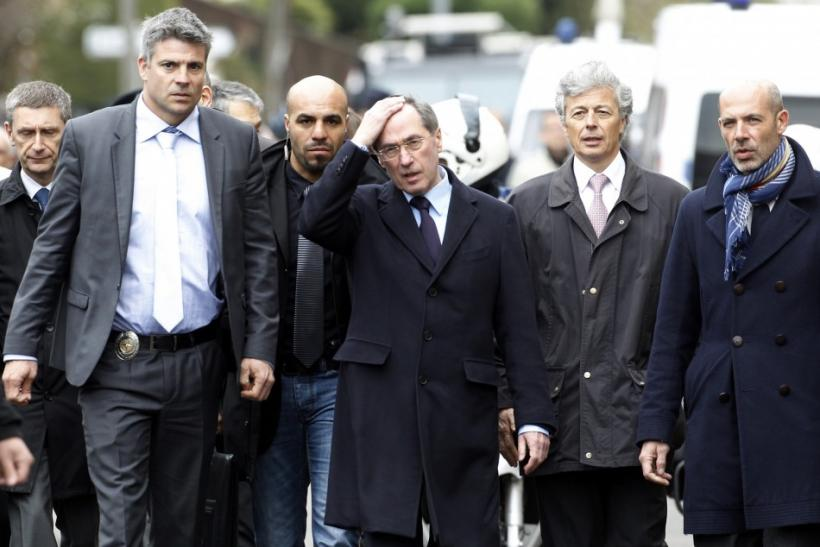 France's Interior Minister Gueant walks to speak to the media after the assault to capture gunman Mohamed Merah during a raid on a five-storey building in Toulouse