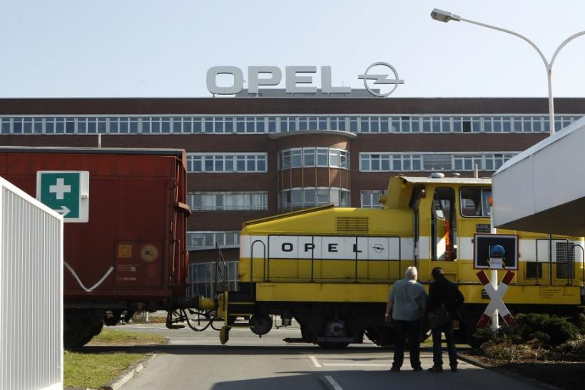 Workers wait in front of the Opel plant of Bochum