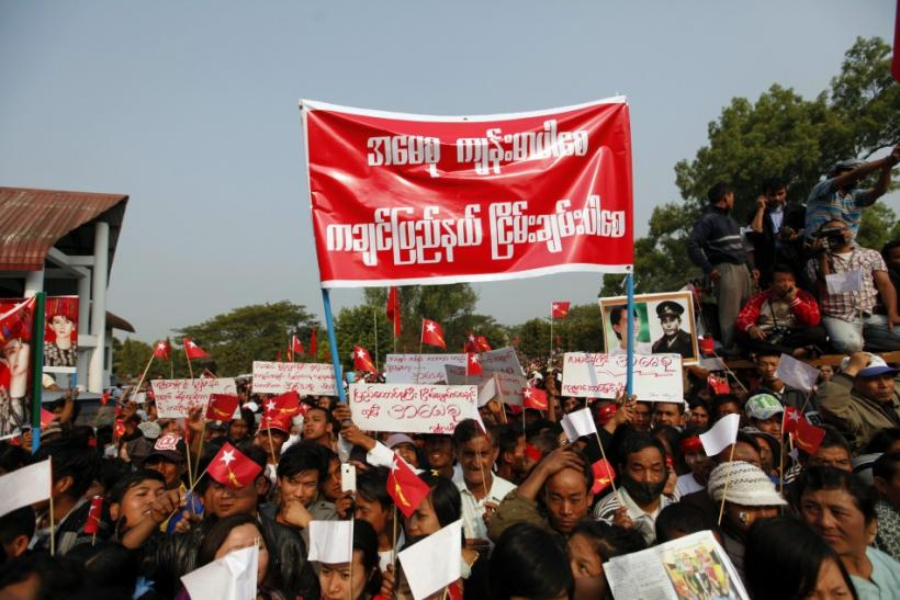 Supporters listen to pro-democracy leader Aung San Suu Kyi's speech at Kachin National Manu park
