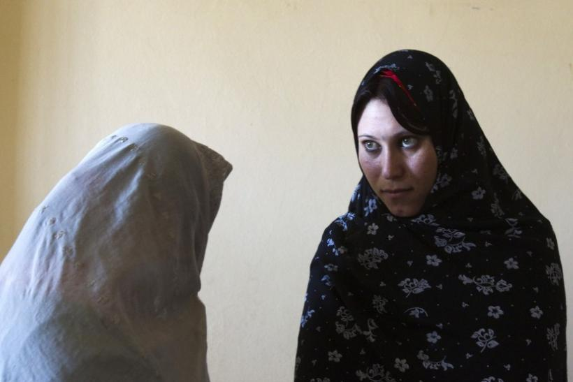 Afghan female prisoners stand in their cell at a prison in Herat