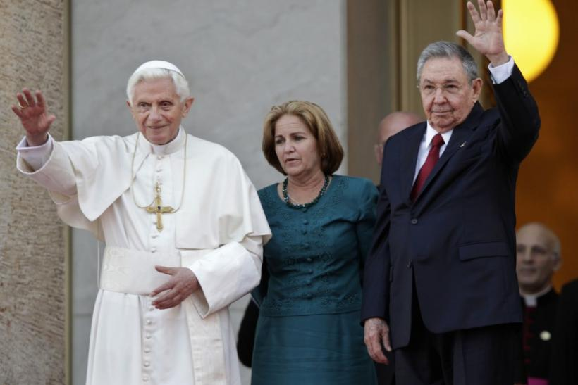 Pope Benedict XVI is welcomed by Cuban President Raul Castro at Revolution Palace in Havana.