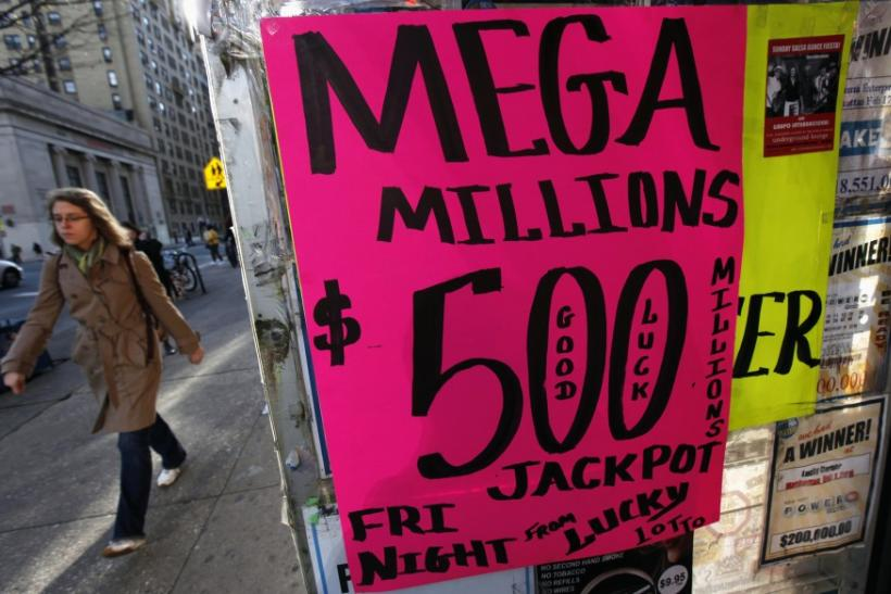 A sign advertises Mega Millions lottery tickets at a shop on New York City's Upper West Side of Manhattan