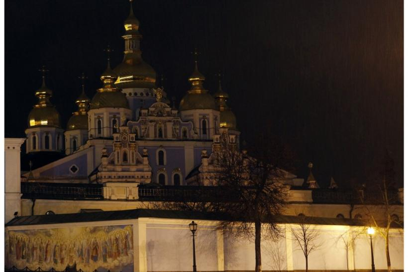 A combination photo shows the Mikhaylo (St. Michael) Golden Cupolas Cathedral before (top) and during Earth Hour in Kiev March 31, 2012.