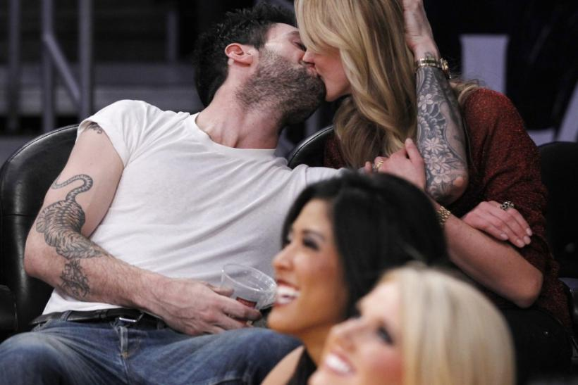 Adam Levine and Anne V.