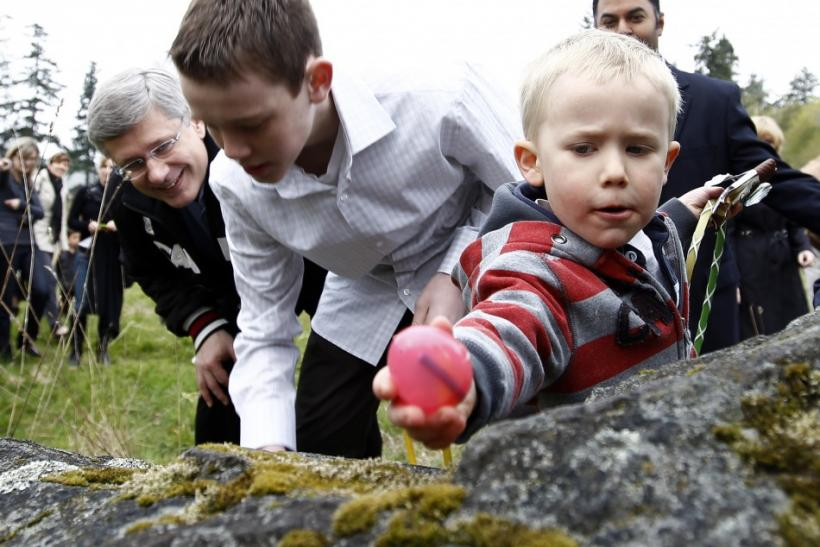 Conservative leader and Canada's Prime Minister Stephen Harper (L) takes part in an Easter egg hunt in Royal Oak, British Columbia April 24, 2011.