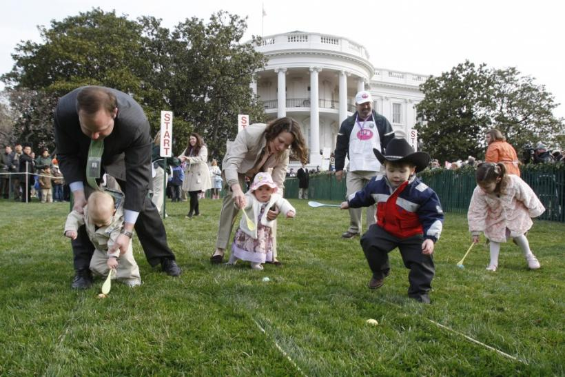 Children, with the help of their parents, take part in the annual Easter Egg Roll on the South Lawn of the White House in Washington, March 24, 2008.