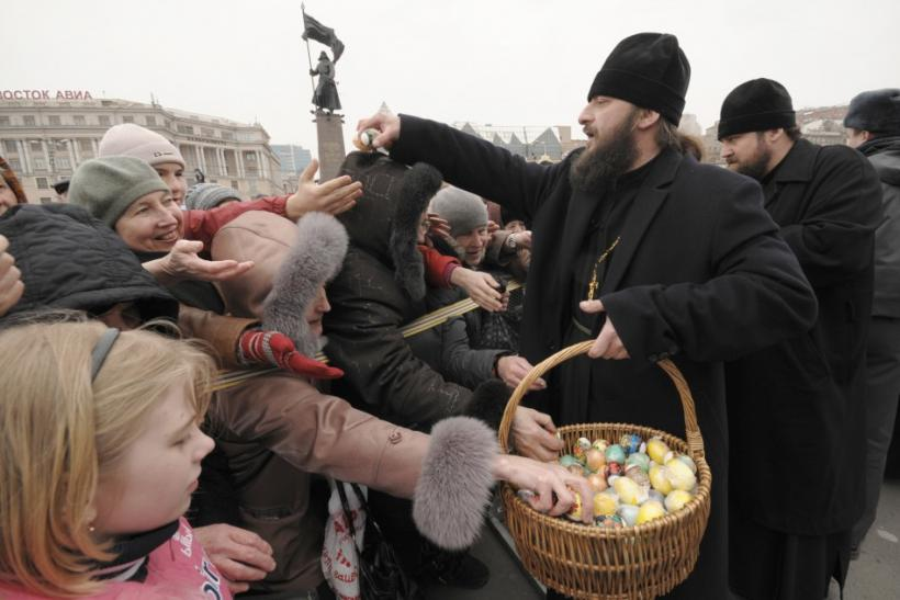 Orthodox priests distribute Easter eggs in the central square of Russia's far eastern city of Vladivostok during the celebration of the Easter April 4, 2010.