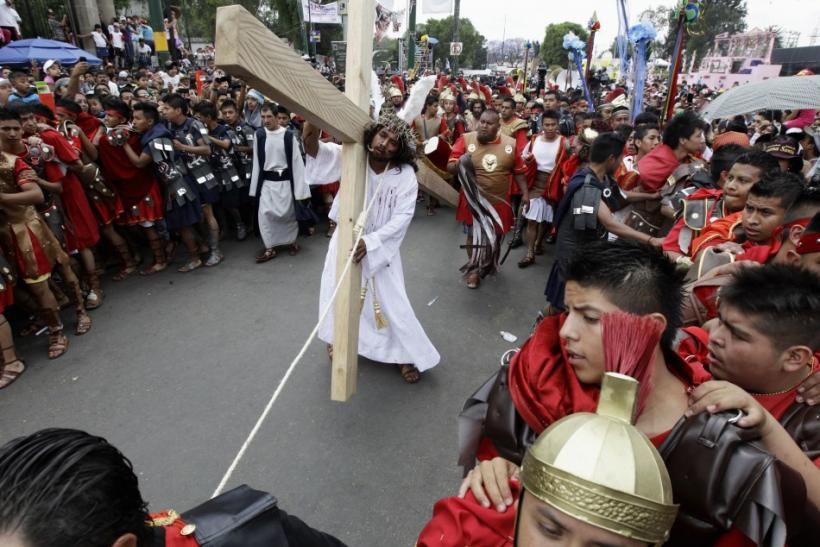 Penitents participate in a re-enactment of the crucifixion of Jesus Christ on Good Friday in Iztapalapa in Mexico City April 6, 2012.