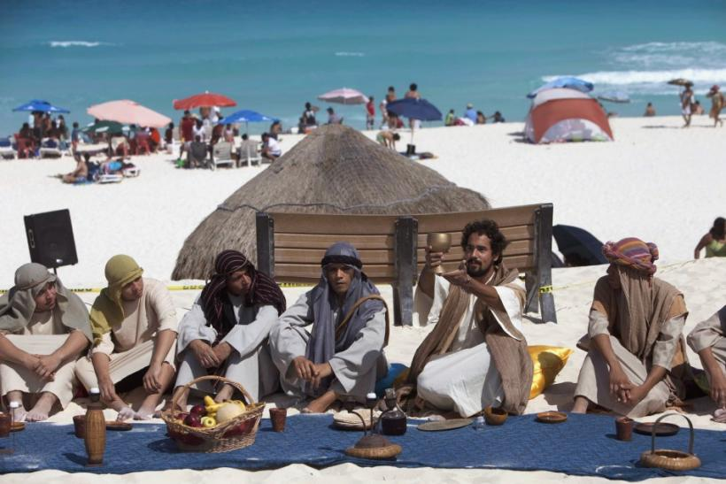 Penitents and actors re-enact the last supper on Playa Delfines (Dolphin Beach) on Good Friday in Cancun April 6, 2012.