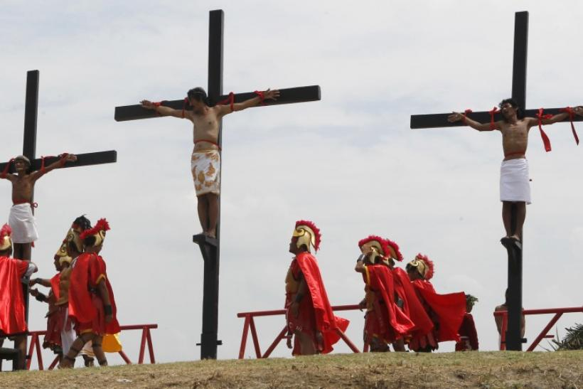 Filipino penitents are nailed to wooden crosses during a reenactment of Jesus Christ's crucifixion during Good Friday in Barangay Cutud, San Fernando, Pampanga in northern Philippines April 6, 2012.