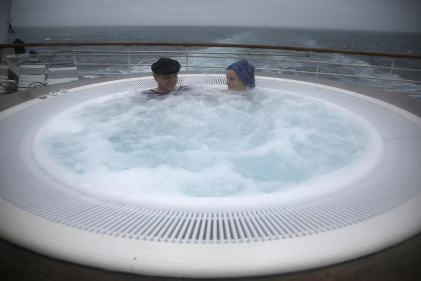 Norwegians sit in a hot tub on the Titanic Memorial Cruise as it moves through high winds off Cobh