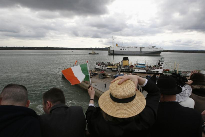 Sharon Sutton of Dublin waves as the Titanic Memorial Cruise leaves port in Southampton