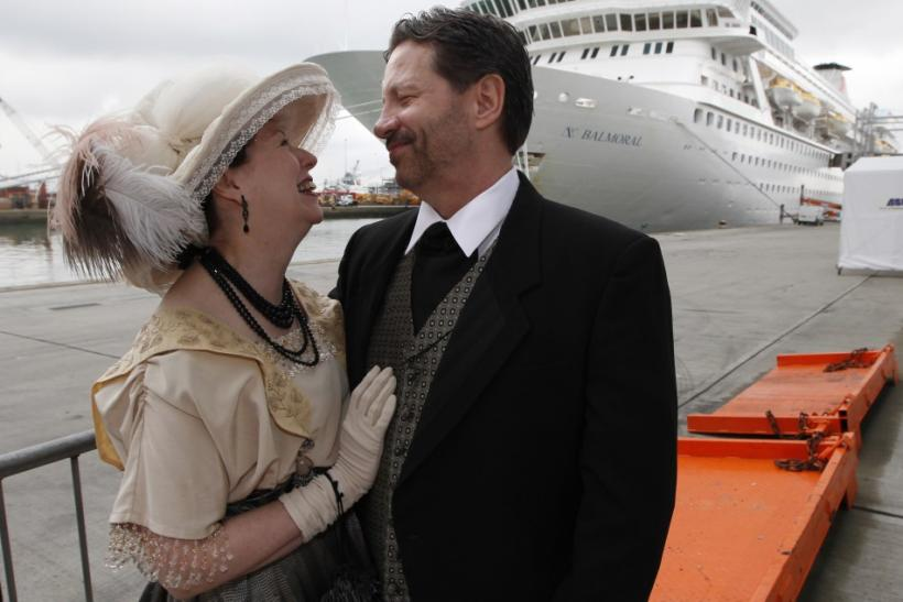 Newlyweds pose while wearing period costume before boarding the Titanic Memorial Cruise in Southampton, England