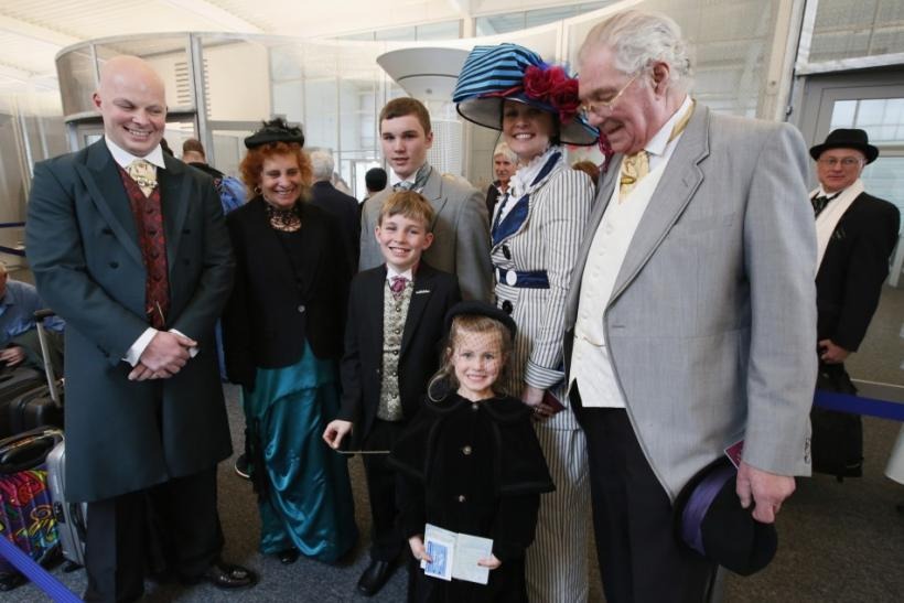 Three generations of the Free family wear period costumes as they queue to board the Titanic Memorial Cruise in Southampton