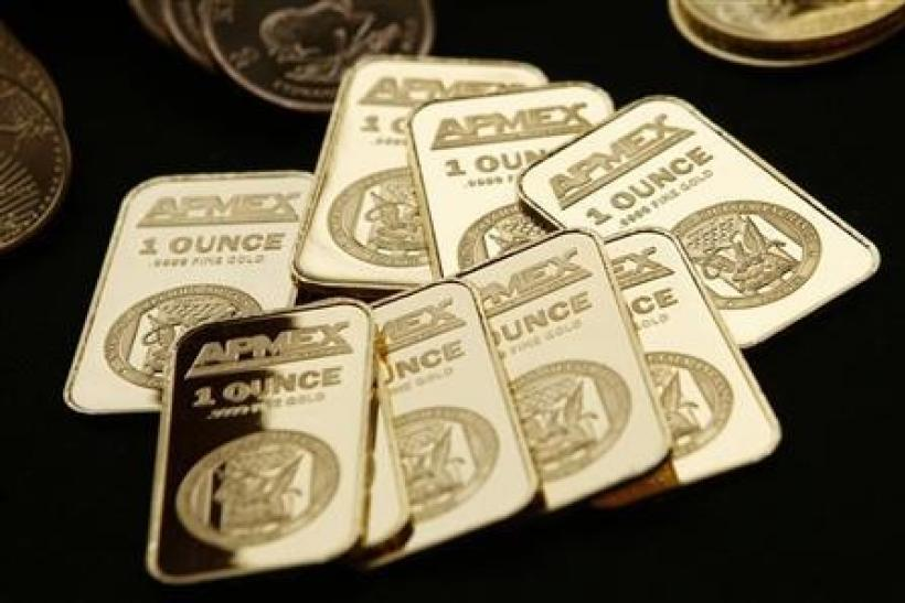 Gold pauses after rally, focus on euro zone