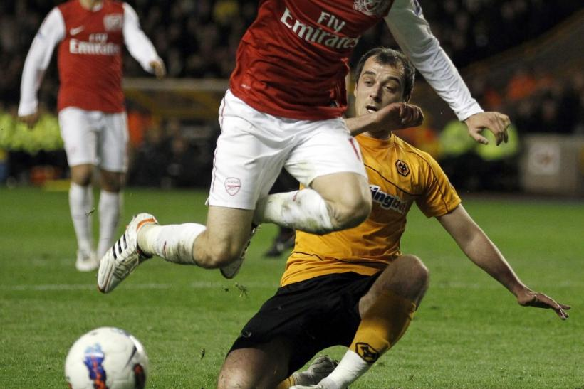 Arsenal's Aaron Ramsey jumps a tackle during their win over Wolves.
