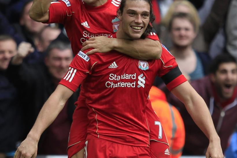 Liverpool's Luiz Suarez and Andy Carroll celebrate after downing Everton 2-1.
